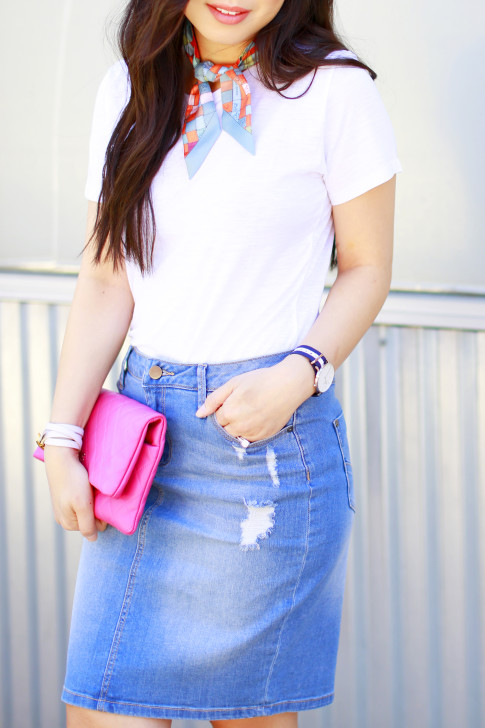 An Dyer wearing Hermes Twilly Neck Tie, Chanel Hot Pink Clutch, Denim Pencil Skirt