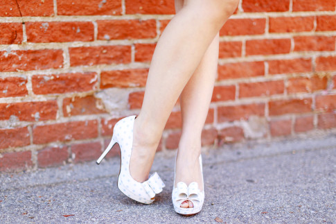 An Dyer wearing Palter Deliso Light Blue Dot Bow Pumps