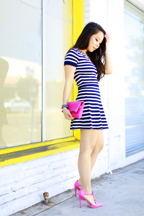 An Dyer wearing Lucy Paris Navy Striped Skirt Set with Hot Pink pumps