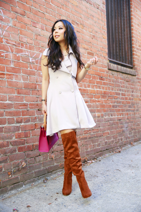 An Dyer wearing Chicwish Belted Sleeveless Trench Dress with Brown Over The Knee Boots