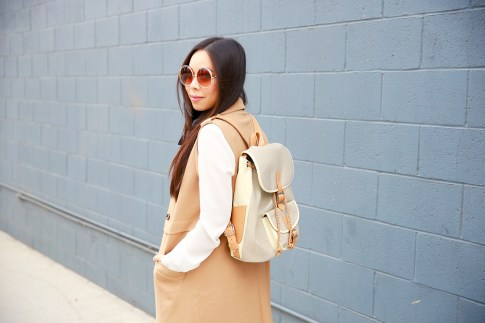 An Dyer wearing Chloe inspired Sunglasses with Sleeveless Trench Duster, Harper Ave Mini Le Corb Shiny Backpack