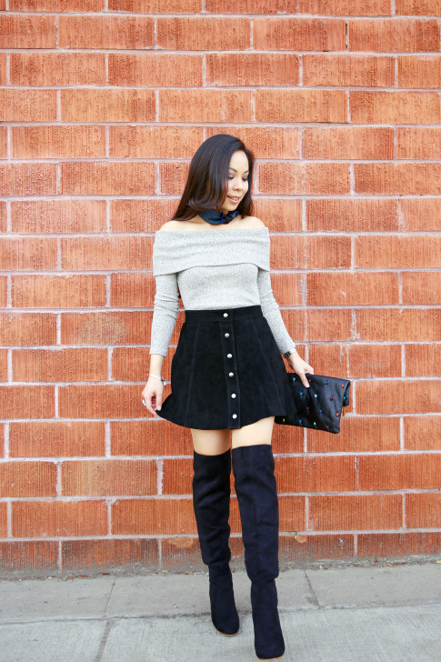 An Dyer wearing Hermes Gavroche Neck Scarf, Grey Off the Shoulder Sweater Suede Button Front Skirt and OTK Boots