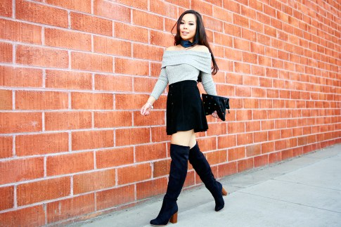 An Dyer wearing Hermes Neck Scarf, Grey Off the Shoulder Sweater Suede Skirt Over The Knee Boots