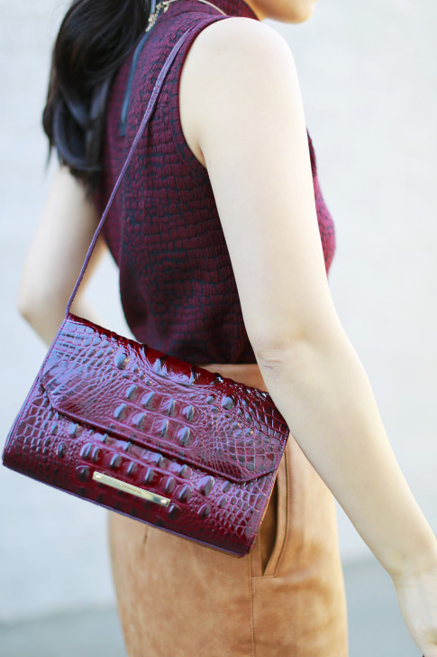 An Dyer wearing Brahmin Carina Shoulder Bag in Carmine Red Melbourne