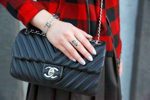 An Dyer wearing Chanel Like A Chevron Flap with ThePeachBox Roman Numerals Bracelet & Edge of Ember Ring