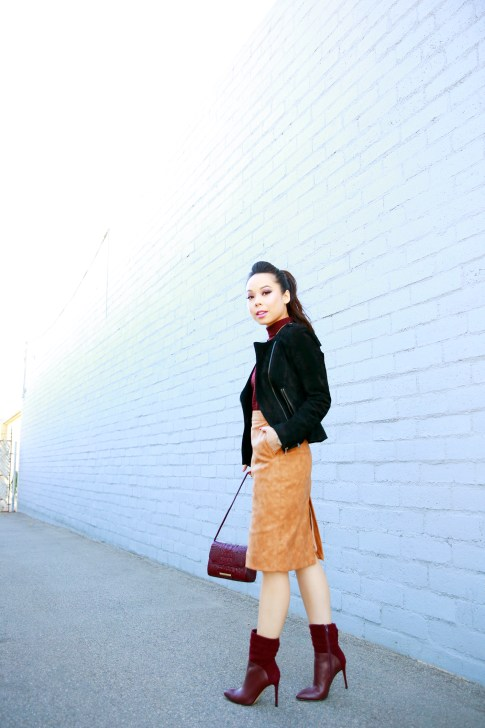 An Dyer wearing Pompadour Ponytail, Forever 21 Suede Jacket, House of CB Skirt, Guess Vvidlet Boots, Brahmin Bag