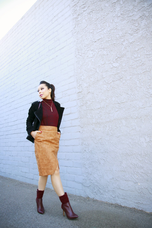 An Dyer wearing Pompadour Ponytail,Forever 21 Suede Jacket, House of CB Skirt, Guess Vvidlet Boots