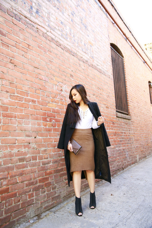 An Dyer wearing Cuyana clutch, Ro&DeNoir SIENNA COAT & Level 99 Tan Suede Skirt, ShoeDazzle Seli