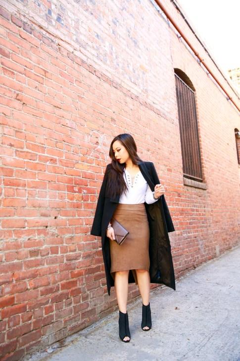 An Dyer wearing Cuyana clutch, Ro&DeNoir SIENNA COAT & Level 99 Tan Suede Skirt, ShoeDazzle Seli