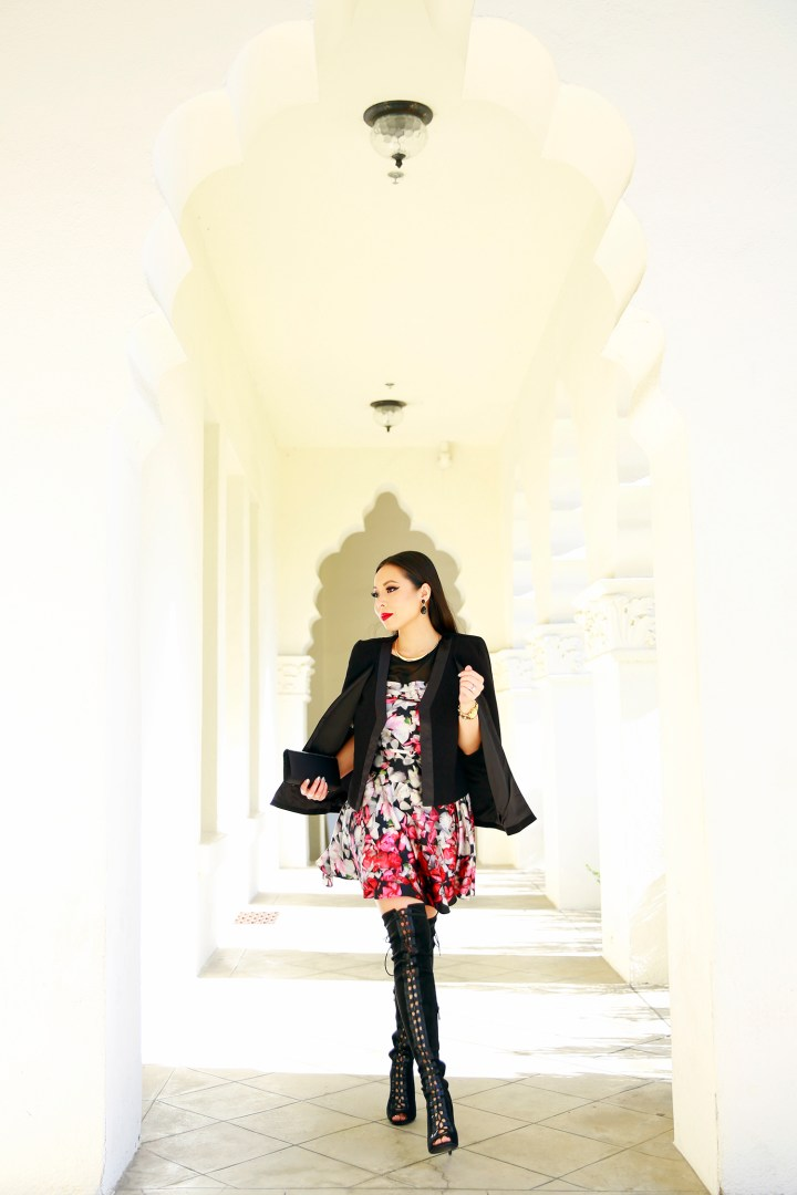 An Dyer wearing Lace Up OTK Boots, Amanda Uprichard Dress with Cape Jacket
