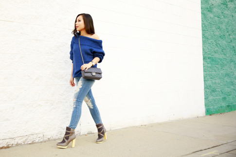An Dyer wearing Marine Blue Chic Wish Off The Shoulder Sweater with Fidelity Distressed Jeans & Australian Luxe Collective Boots