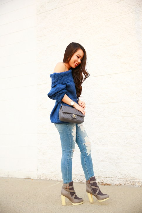 An Dyer wearing Marine Blue Chic Wish Off The Shoulder Sweater with Fidelity Distressed Jeans