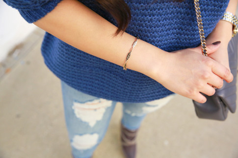 An Dyer wearing My Jewel Bar Feather Bracelet