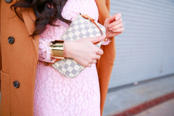 An Dyer wearing Bauble Bar Cuff Bracelet with Louis Vuitton Damier Azur Pouchette