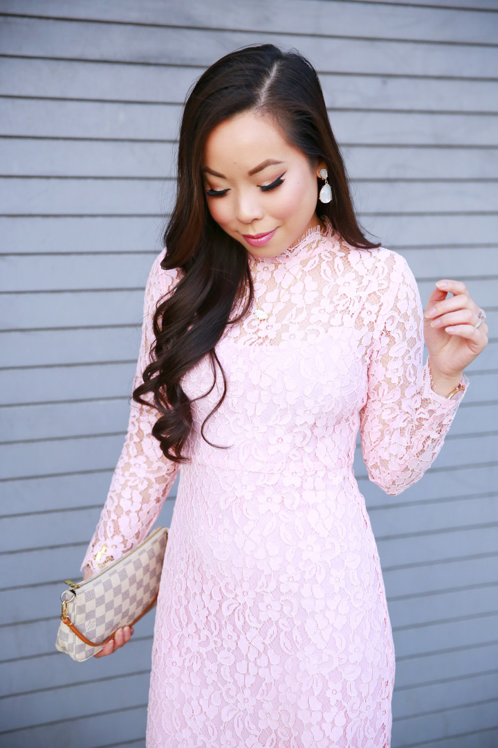 An Dyer wearing CHarming Charlie Clip On Earrings with Chicwish Pink Long Sleeve Lace Midi Dress