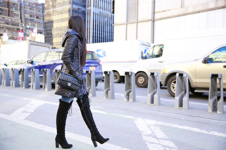 An Dyer wearing Dawn Levy Paig Coat with Ted Muffy Lace Up Over The Knee Boots and Chanel Chevron