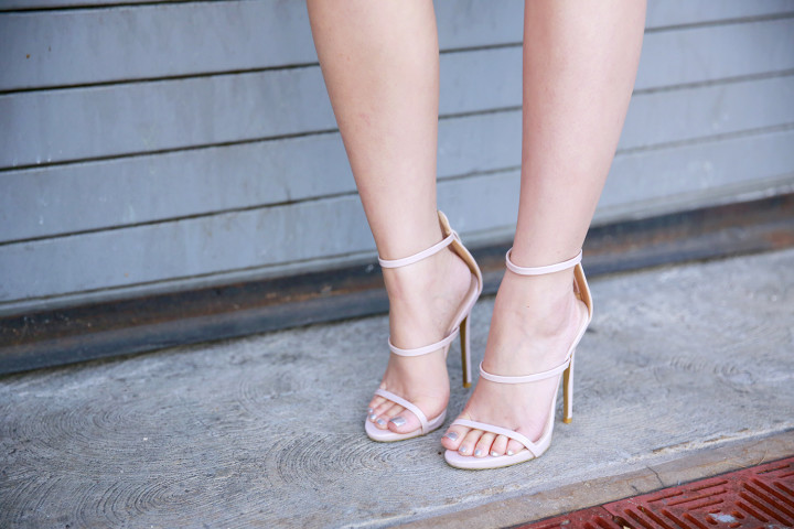 An Dyer wearing Public Desire 3 strap nude sandals