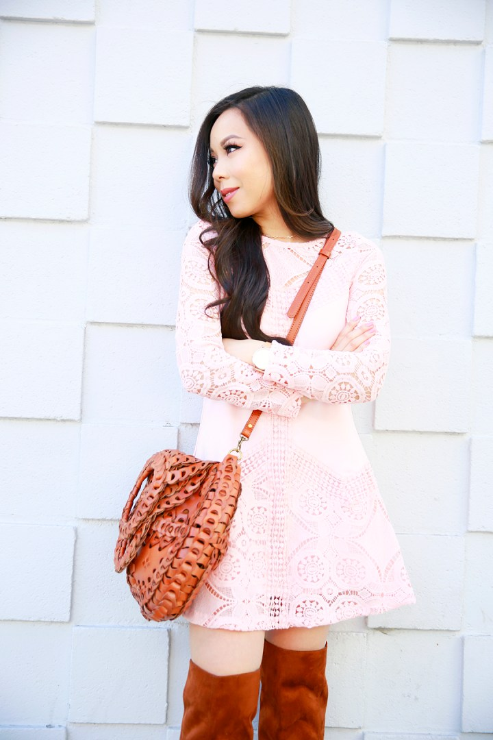 An Dyer wearing Chicwish Pink Blush Crochet Dress with Patricia Nash Bag