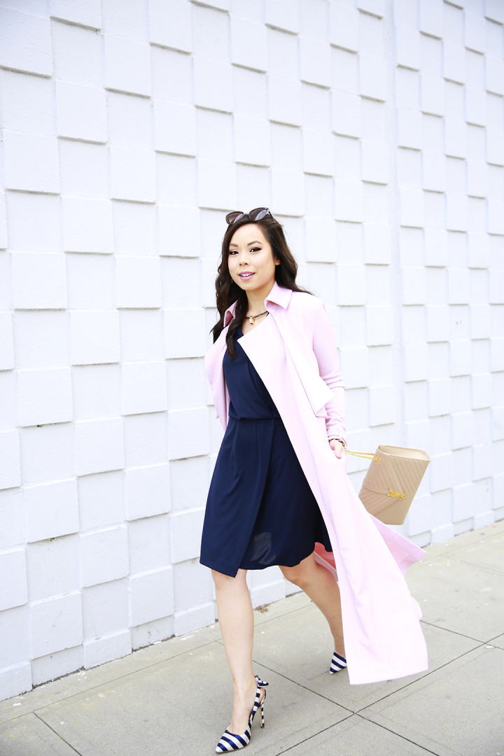 An Dyer wearing LXE Riverside Trench Blush Pink Duster Coat and Navy Stripe Bow Slingback Pumps