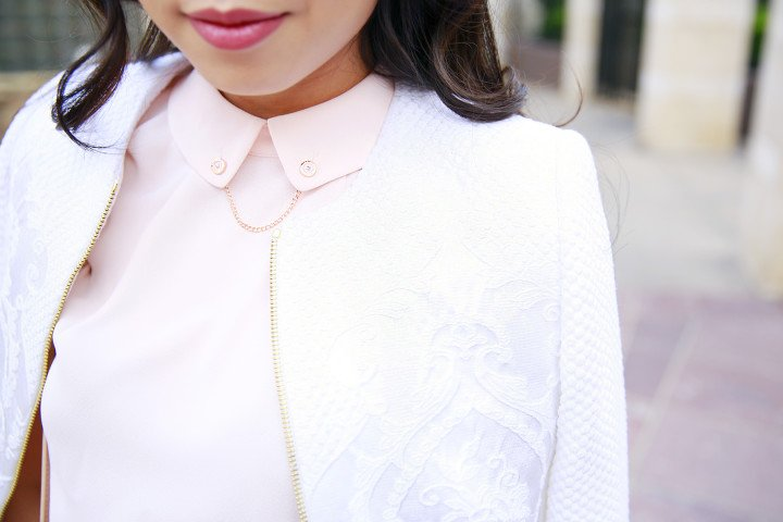 An Dyer wearing Ted Baker LUA Jacquard cropped jacket with GURRA Chain detail collared top