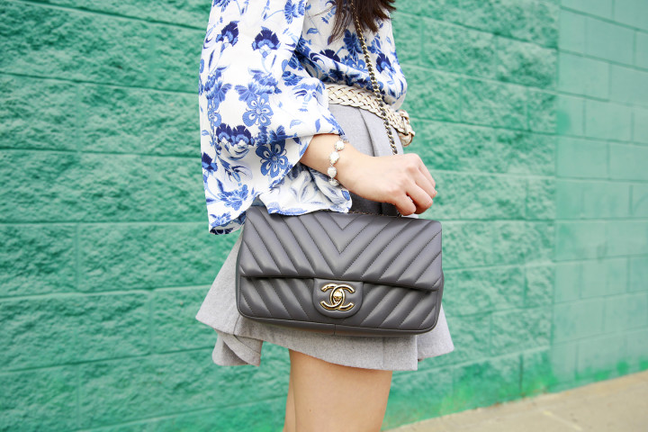 An Dyer wearing Kendra Scott with Grey Chanel Chevron Flap