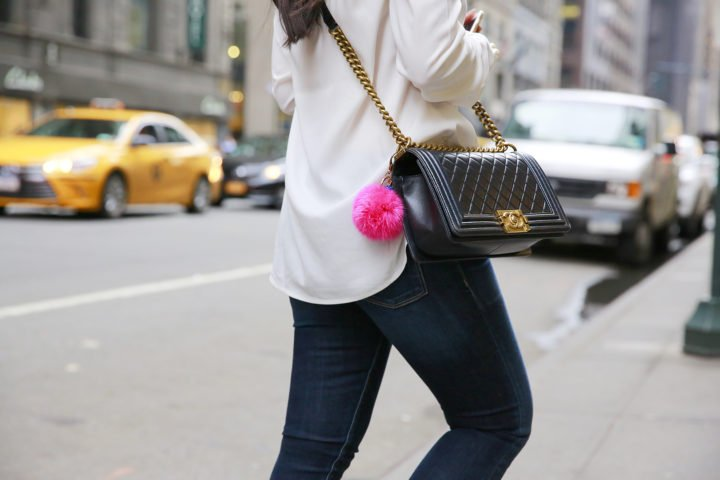 An Dyer Chanel boy black lambskin gold hardware hot pink pom pom