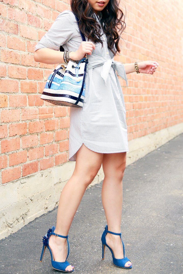 An Dyer in a Samurai Bun wearing Madewell Shirtdress with Brahmin Maxine Bucket Bag and ShoeDazzle Floral Denim Sandals