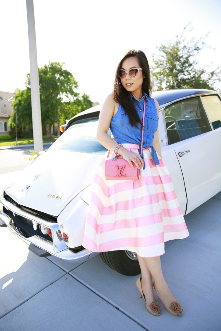 An Dyer wearing Chicwish Candy Pink Striped Full Midi Skirt and Louis Vuitton Louise Corail, Nude Fluffy Pom Pumps