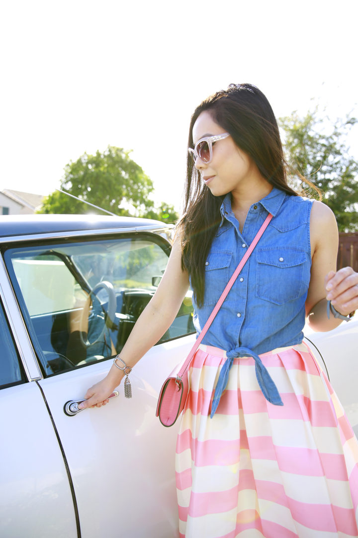 An Dyer wearing Denim Sleeveless Tie Front Top with Pink Striped Skirt