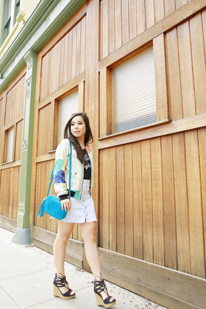 An Dyer wearing teal suede Gucci Soho Disco, Sanctuary Bomber Jacket, Hudson Button Front Denim Skirt, Mari A Jute Wedges