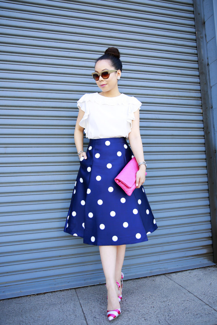 An Dyer wearing Amanda Uprichard Ruffled Top with Navy Polka Dot Skirt and Pink Striped Bow Pumps