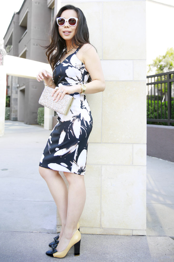 An Dyer wearing Beyond by Ashley Graham and Charming Charlie Sunglasses, Sole Society Clutch