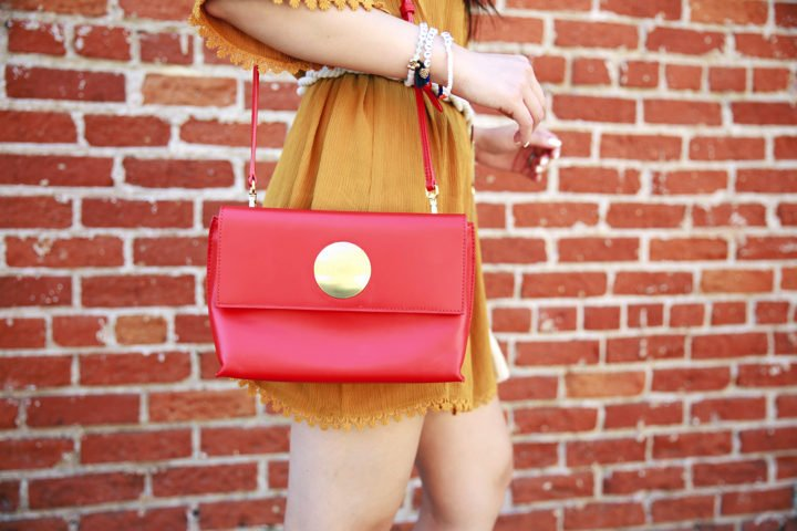 An Dyer wearing shop Flynn handbag bella tomato red