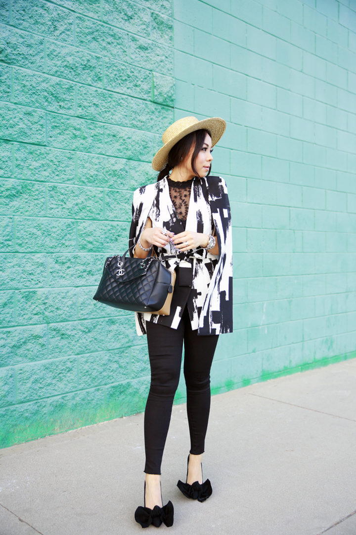 An Dyer wearing Boater Hat with Lavish Alice Cape and CHanel Bag