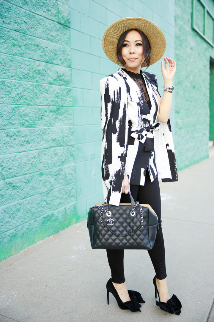An Dyer wearing Lavish Alice Cape with Chanel Tote