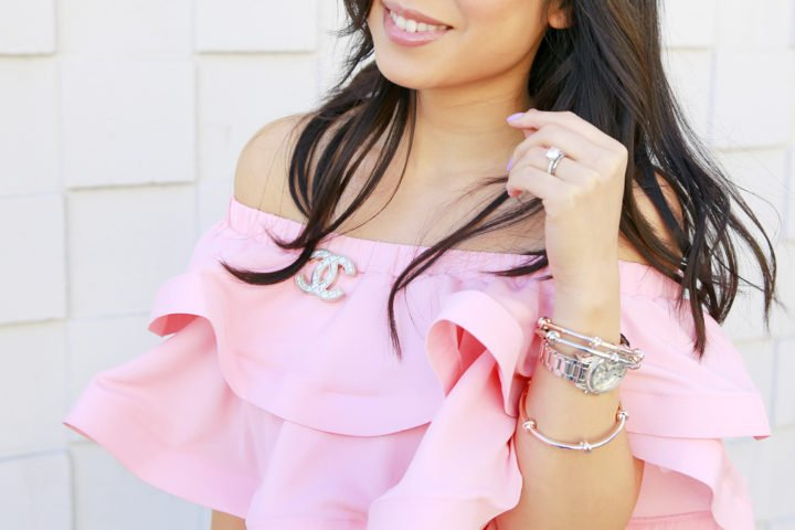 An Dyer wearing Pink Ruffles Off The Shoulder with Chanel Brooch, Charming Charlie Jewelry