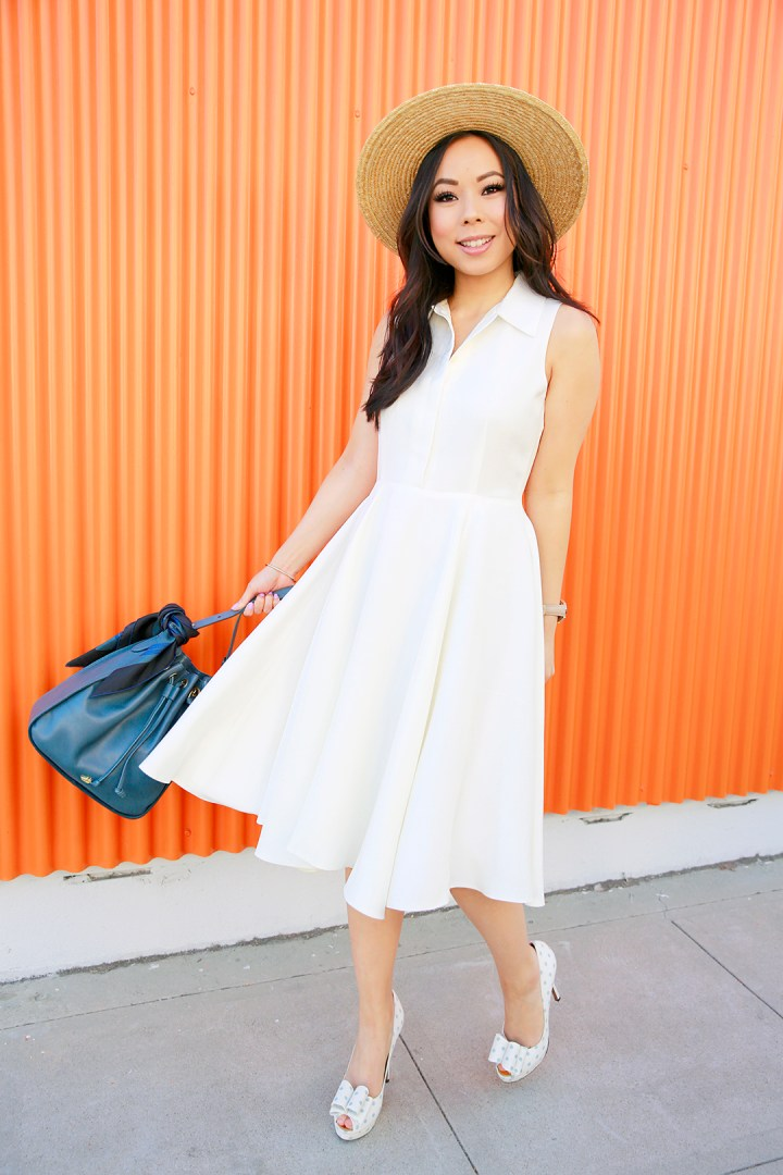 An Dyer wearing Sarah Seven Dress with Brahmin BLAIR CHARLESTON, Hermes Twilly and Palter Deliso Isla Pumps