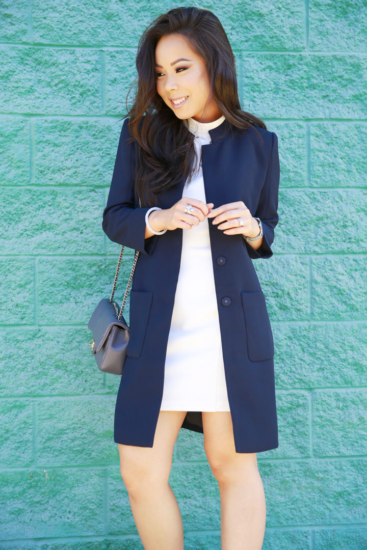 an-dyer-wearing-white-mockneck-minidress-with-armani-exchange-three-button-jacket