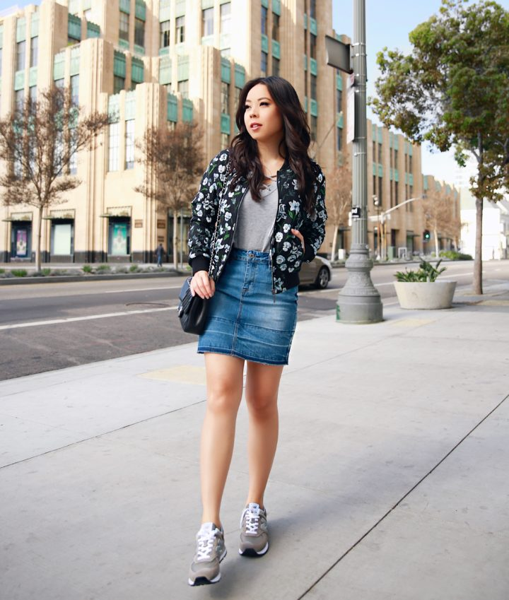 Lifestyle Blogger An Dyer wearing Eva Longoria Collection Floral Bomber Jacket with New Balance Grey 574