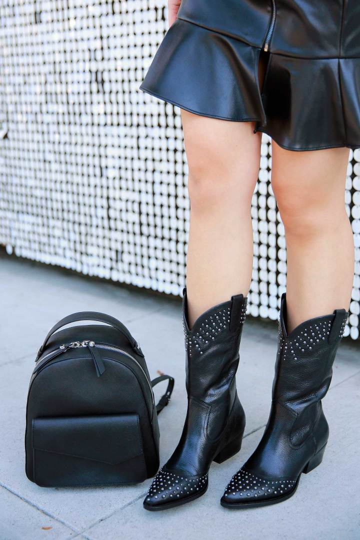 LA Fashion Blogger An Dyer wearing western street style black cowboy boots backpack bag
