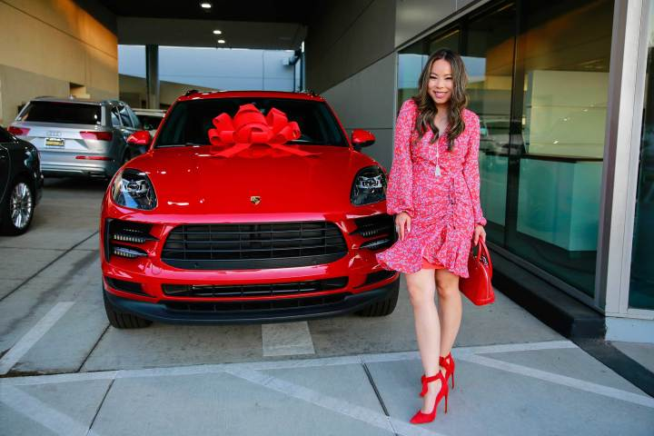 Vietnamese American Blogger An Dyer at Downtown LA Porsche with Carmine Red Macan S Gift Bow