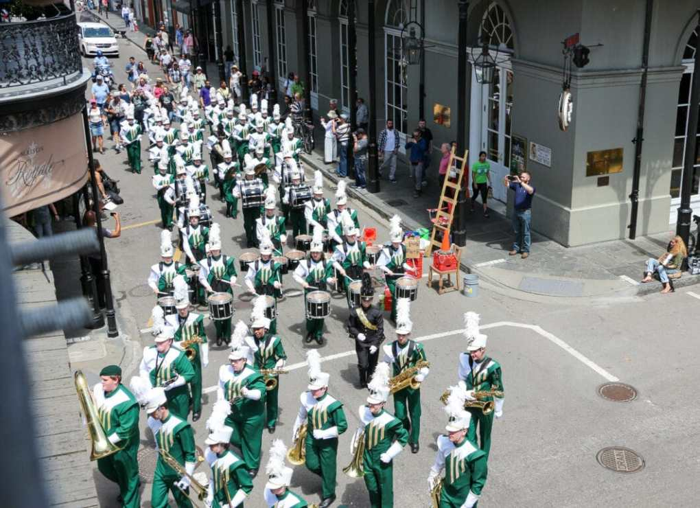 A parade coming through Royal Street