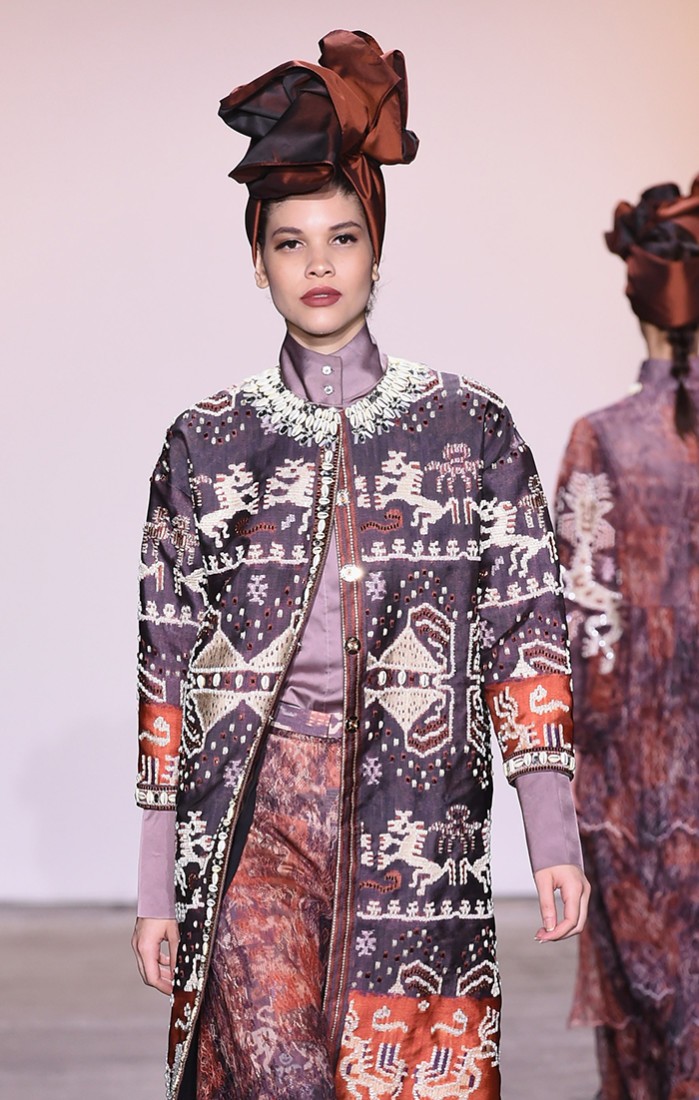 NEW YORK, NY - FEBRUARY 07: A model walks for Itang Yunasz during the runway for the Indonesian Diversity FW19 Collections: 2Madison Avenue, Alleira Batik, Dian Pelangi and Itang Yunas fashion show during New York Fashion Week: The Shows at Industria Studios on February 7, 2019 in New York City. (Photo by Yuchen Liao/Getty Images for Indonesian Diversity)