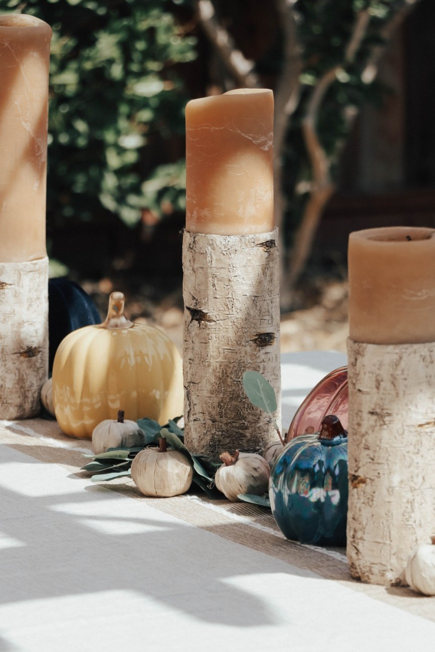Sharing our updated fall home decor theme which is fall jewel tone decor. I'm loving the mix of our old and new pieces. Click on over to the post to check it out! #fallhomedecor #falltablescape #coloredpumpkins