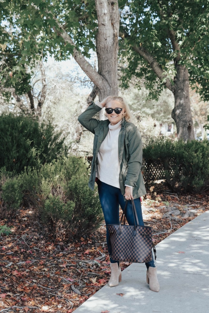 How to style Spanx faux leather leggings for fall. Sharing 5 Fall Outfits Wearing Spanx Leather Leggings on the blog. Head over to the post to check out all the looks. #falloutfits #spanxleggings #fauxleatherleggings