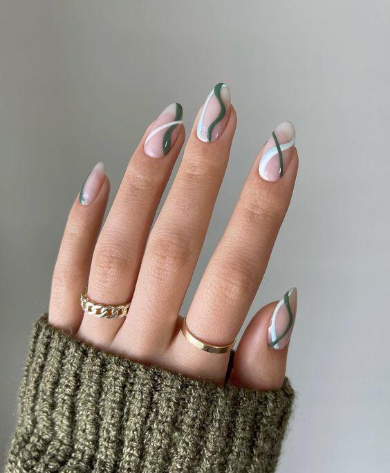 Green and blue wavy nail art