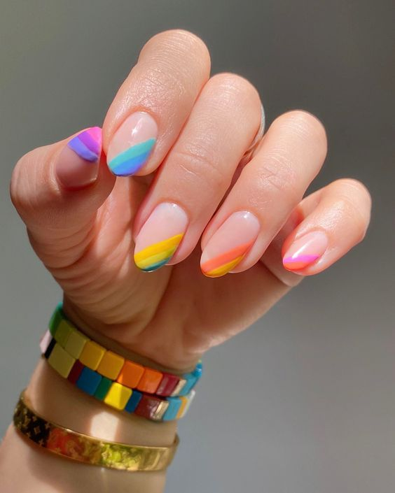 Rainbow asymmetrical tip manicure