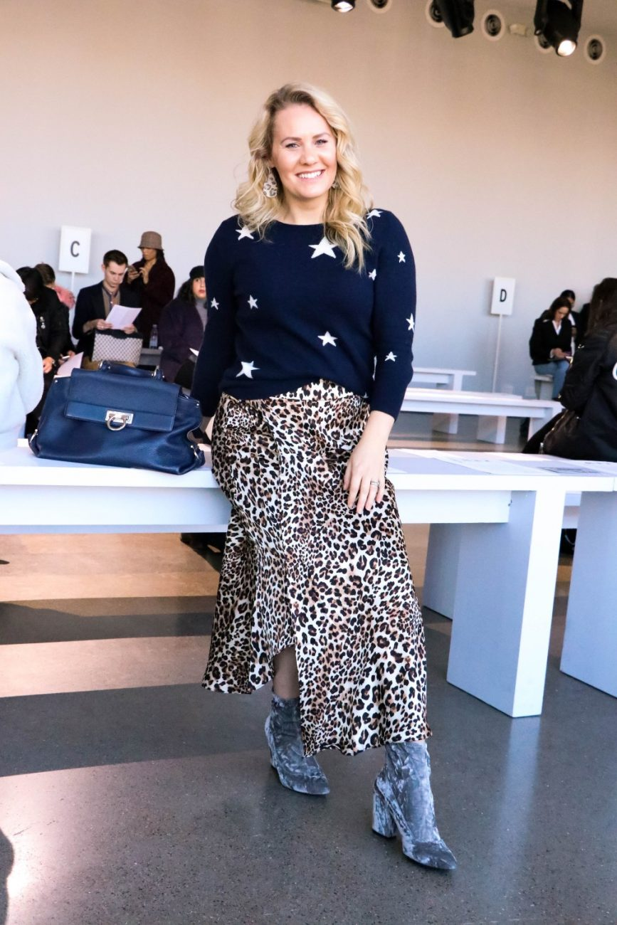 Another Print Mixing Outfit That I Wore During NYFW. This Star Cashmere Sweater and Leopard Print Skirt Outfit Is Featuring 2 Closet Staples I Think Everyone Needs In Their Wardrobe! Click on the photo to check out the full post + get outfit details! #NYFW #StreetStyle #NYCStreetStyle #PrintMixing #OutfitInspiration