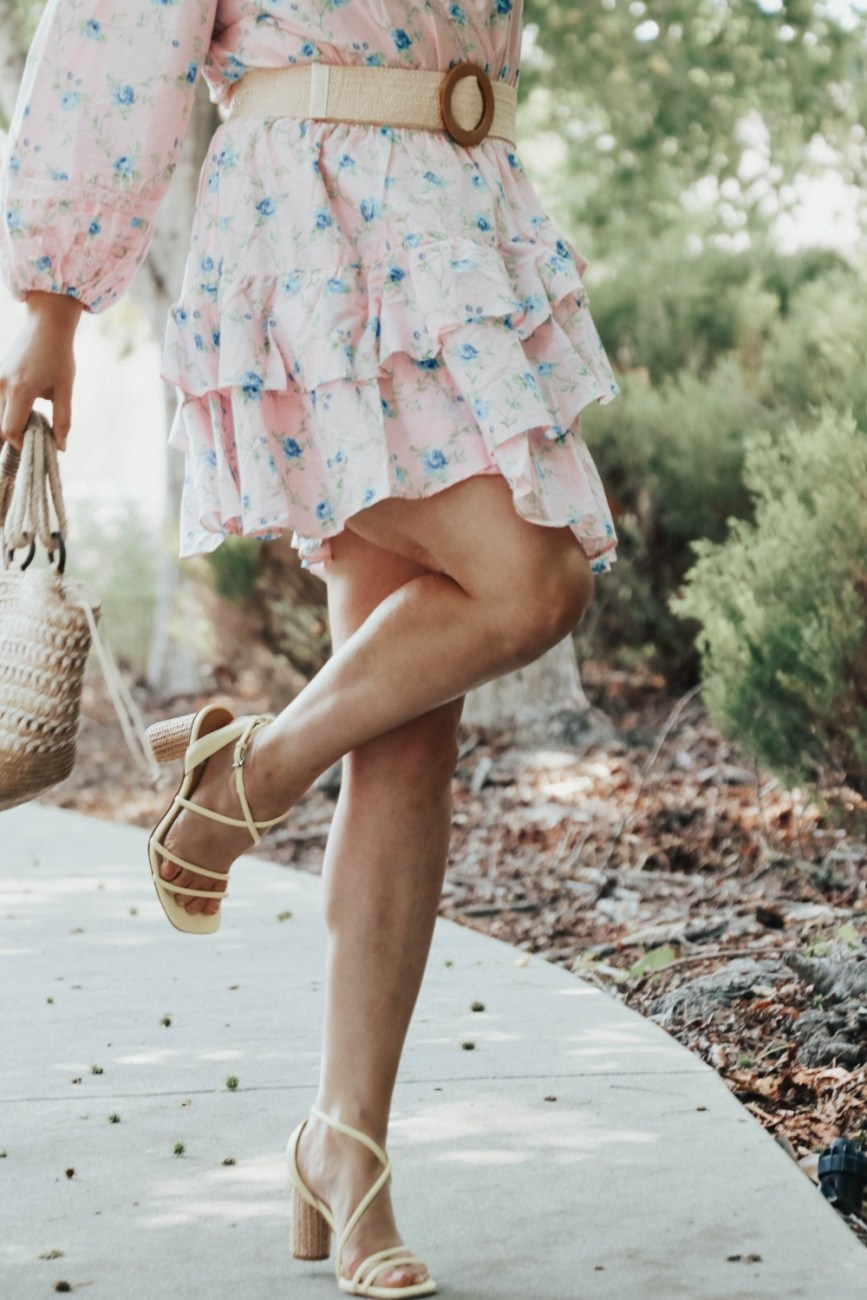 Summer pastel floral dress with strappy sandals and a woven summer bag. #haveneedwant #summerdress #summeroutfit #summersandals