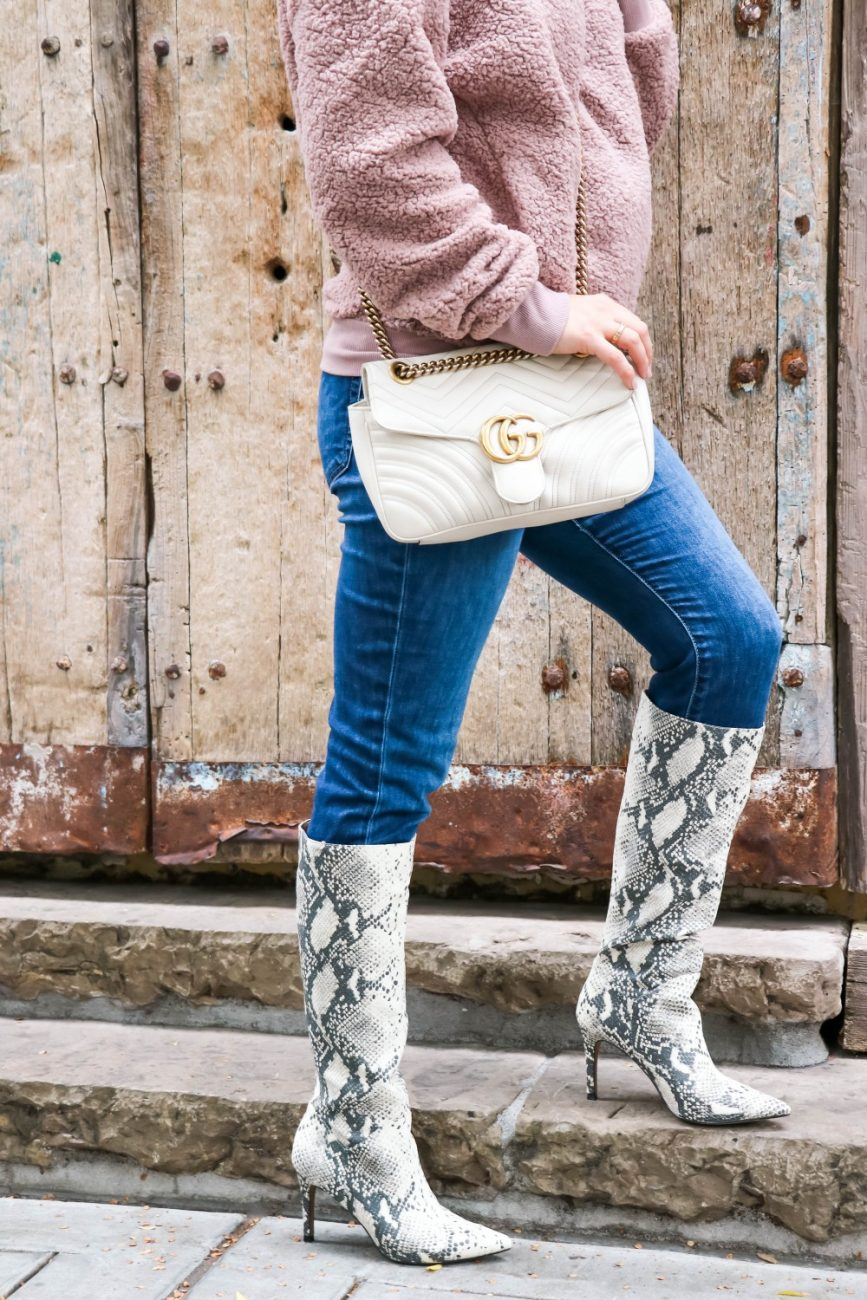 I'm obsessed with these snakeskin print boots from Steve Madden!! They're currently on sale for 40% OFF so head to the blog to get details on where to shop them on sale! #stevemadden #stevemaddenboots #snakeskinprint #snakeskinprintboots